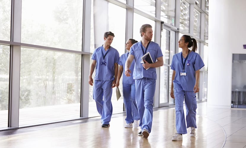 Doctors walking down a hall